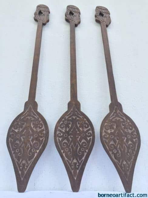 CARVED TRIBAL PADDLE