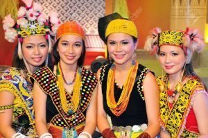 dayak girl in Borneo beauty pageant with traditional costume