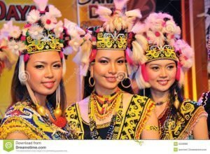 dayak girl in Borneo with ceremonial costume